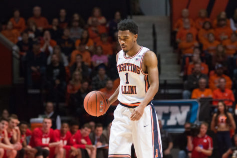 Illinois' Jaylon Tate walks the ball up the court during the Illini's 78-67 loss to Nebraska at State Farm Center on Saturday.