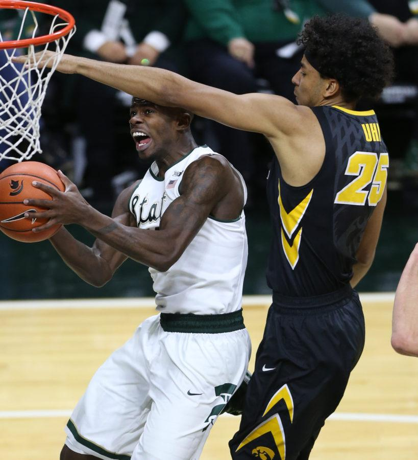 Michigan State's Eron Harris, left, is defended by Iowa's Dom Uhi during the first half at the Jack Breslin Student Events Center in East Lansing, Mich., on Thursday, Jan. 14, 2016. Iowa won, 76-59. (Kirthmon F. Dozier/Detroit Free Press/TNS)