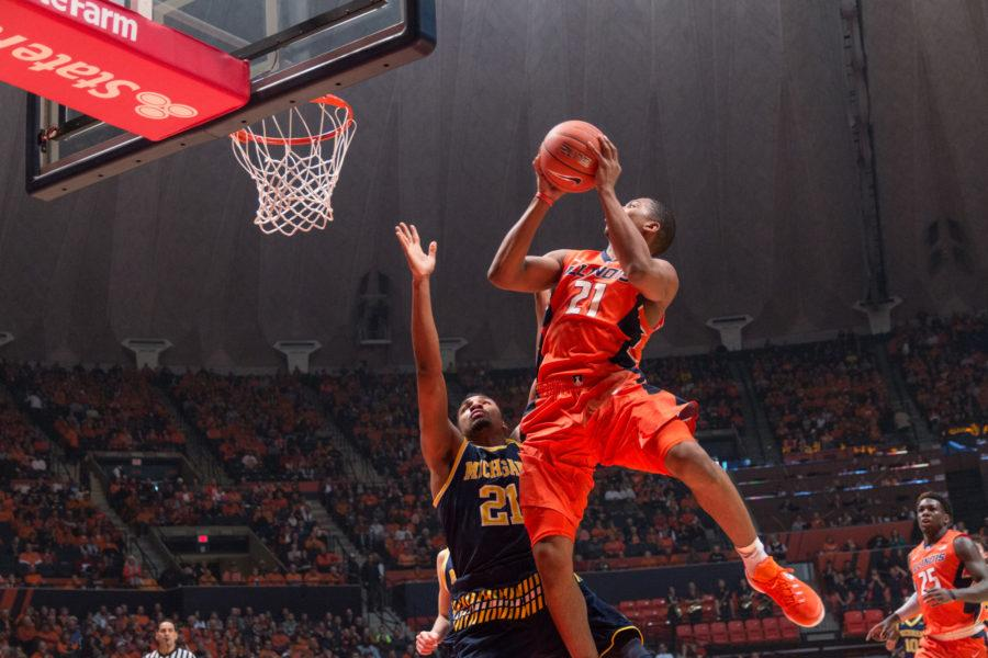 Illinois' Malcolm Hill goes airborne while on a fast break during the Illini's 78-68 loss to Michigan at State Farm Center on Wednesday, December 30.
