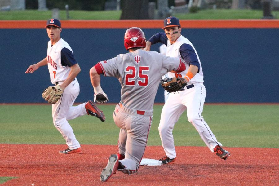 Illinois' Adam Walton (6) attempts to tag out Indiana's Brad Hartong (25) during the baseball game v. Indiana at Illinois Field on Friday, Apr. 17, 2015. Illinois won 5-1.