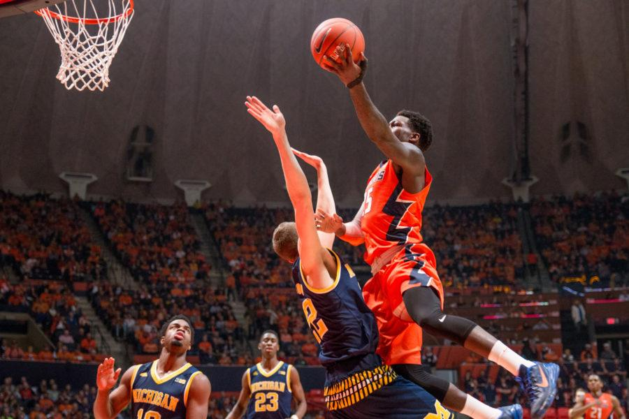 Illinois' Kendrick Nunn takes a layup over a Michigan defender during the game against Michigan at the State Farm Center on Wednesday, December 30, 2015. The Illini lost 78-68.
