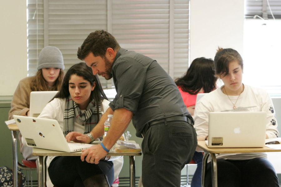 Isabelle Martini, a junior, gets help on her assignment from her English teacher Ed Sandt, center, during class, November 19, 2012, in Montvale, New Jersey. Pascack Hills High School has been issuing students laptop computers in their classrooms for the past nine years. (Tariq Zehawi/The Record/MCT)