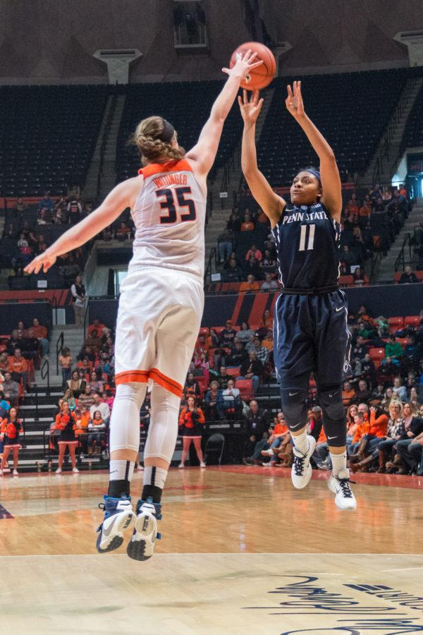 Penn+State%27s+Teniya+Page+shoots+a+3-pointer+over+Illinois%27+Alex+Wittinger.+Teniya+scored+17+points+in+the+second+half+to+help+the+Nittany+Lions+defeat+the+Illini+65-56+on+Saturday%2C+Jan.+23+at+State+Farm+Center.