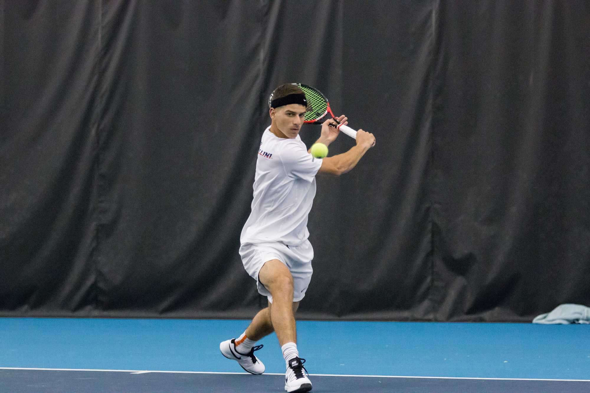 Illinois' Aron Hiltzik returns the ball during the match against Valparaiso at the Atkins Tennis Center on Friday, January 22, 2016. Illinois won 4-0.