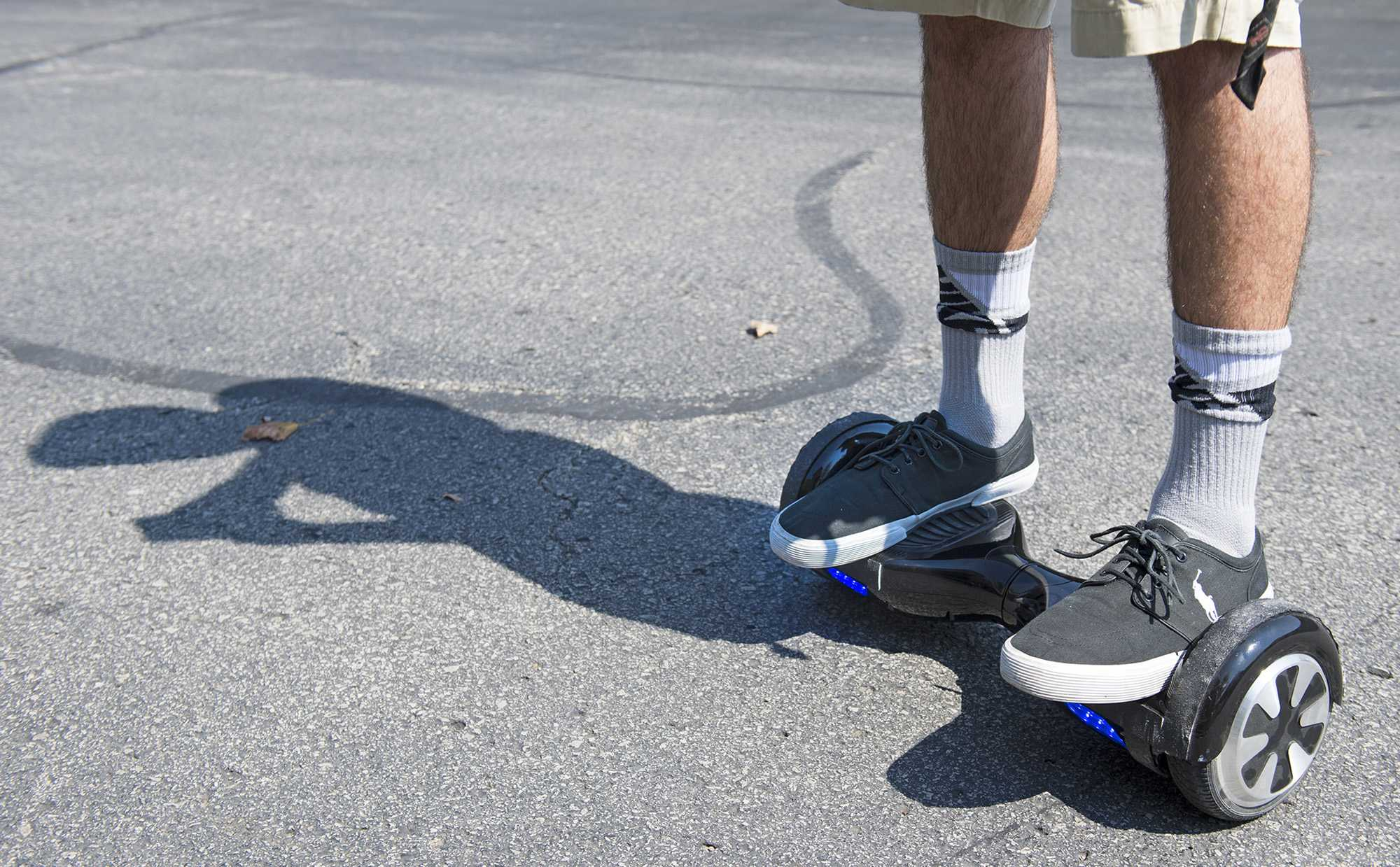 Logan Meis, 20, balances on his hover board outside his apartment complex in Overland Park, Kan., on Friday, Sept. 4, 2015. Meis purchased the personal transportation device for about $330 online. (Tammy Ljungblad/Kansas City Star/TNS)