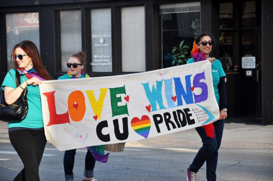 Residents+walk+through+Main+Street+at+the+Champaign+Pride+Parade+in+2015.++
