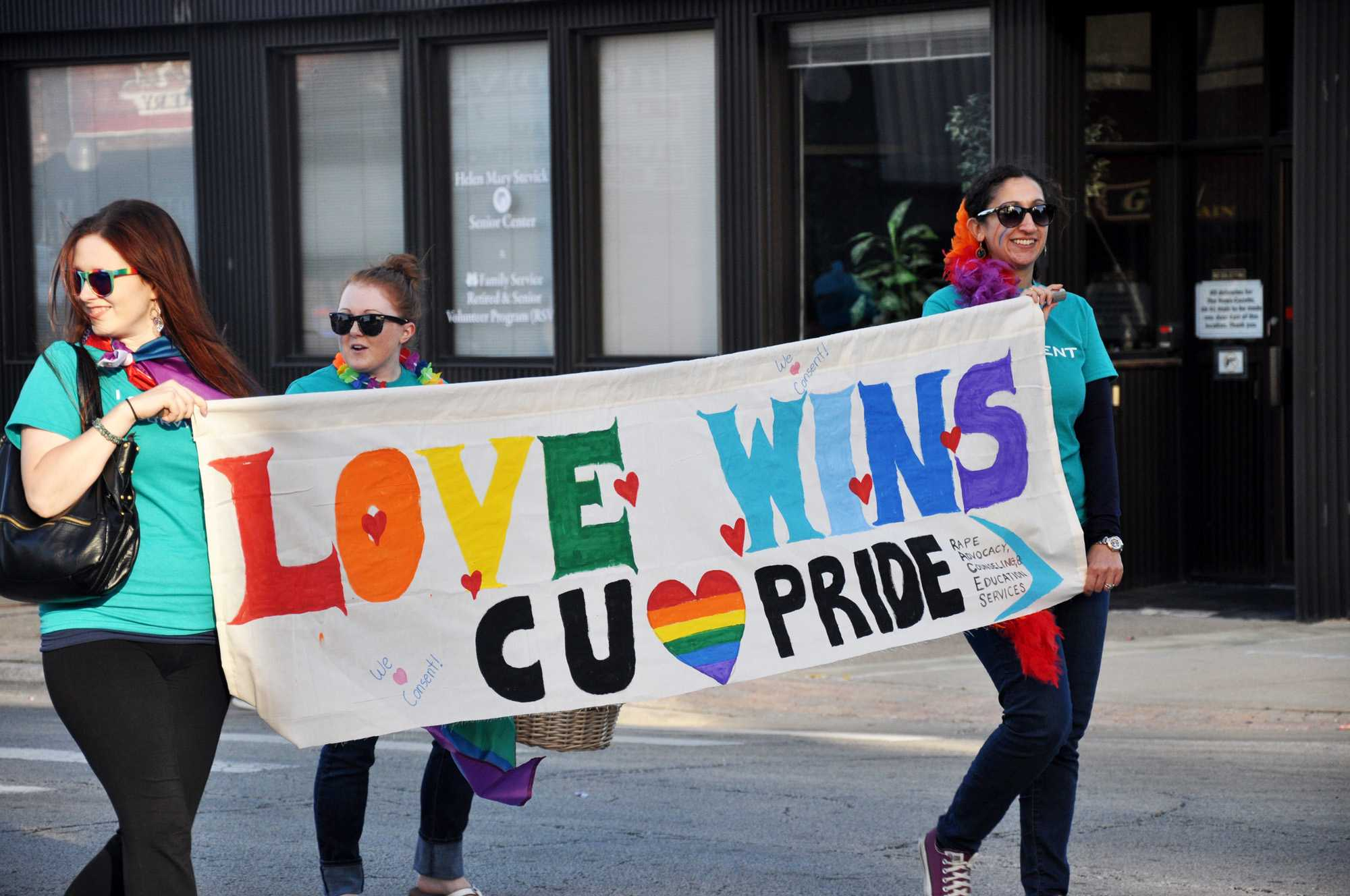Residents walk through Main Street at the Champaign Pride Parade in 2015.
