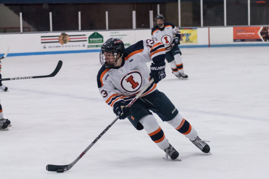 Illinois' James Mcging (13) looks for an open pass during the game against Western Michigan University at the Ice Arena on Saturday, Dec. 12, 2015. Illinois won 4-3.