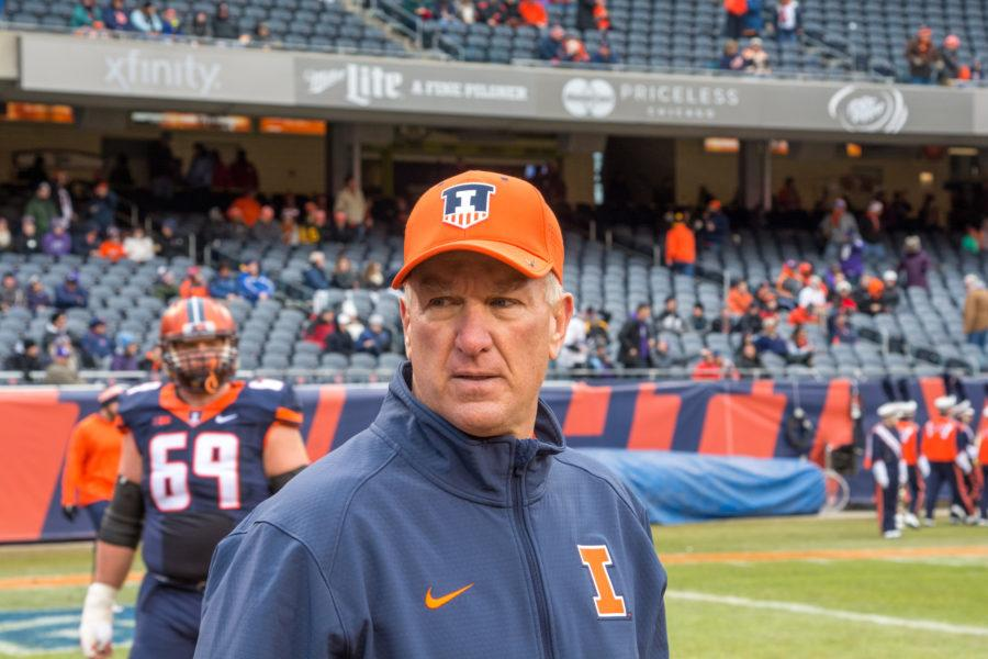 Head coach Bill Cubit watches his seniors line up to be honored on Senior Day before the game against Northwestern at Soldier Field on Saturday, Nov. 28.