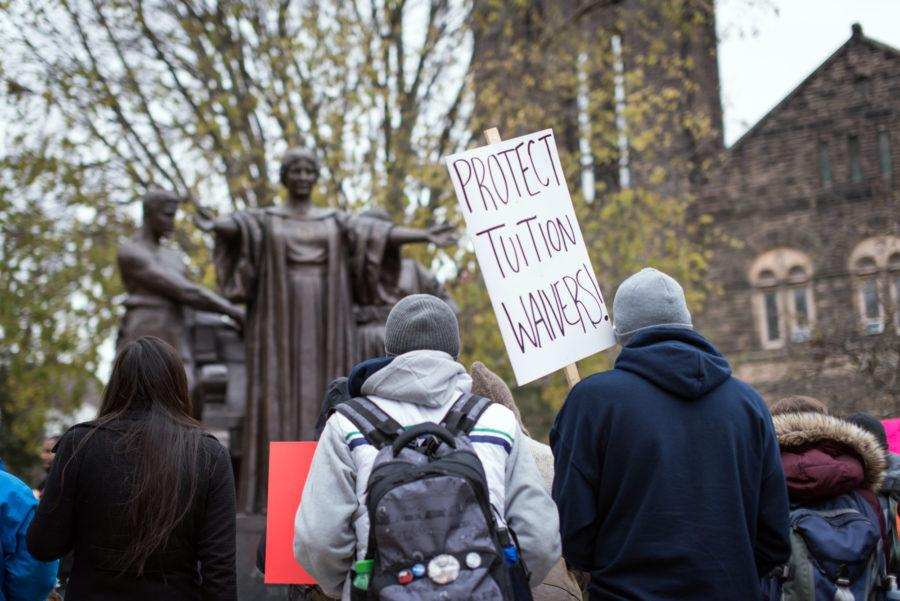 Students and faculty gather around the Alma Mater to voice support for graduate employee tuition waivers on Nov. 12, 2014.