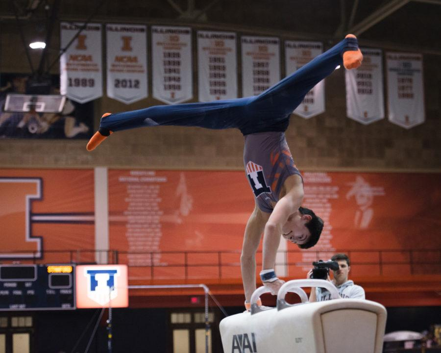 Illinois' Brandon Ngai performs a routine on the pommel horse during the meet against Stanford at Huff Hall on Friday, March 6, 2015.The Illini lost 21-9.