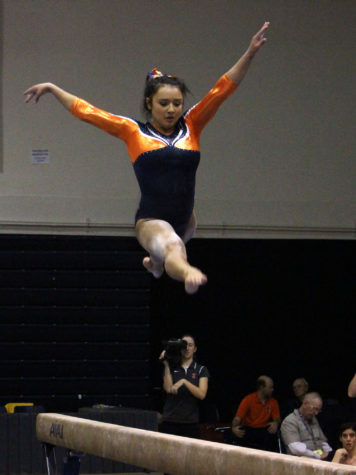 Lizzy LeDuc on the balance beam during the match against Michigan at Huff Hall on January 22, 2016. Michigan won 196.825 to 195.15.