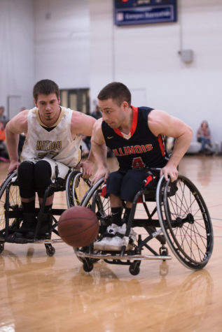 Illinois men's head wheelchair basketball coach happy with team's midseason form