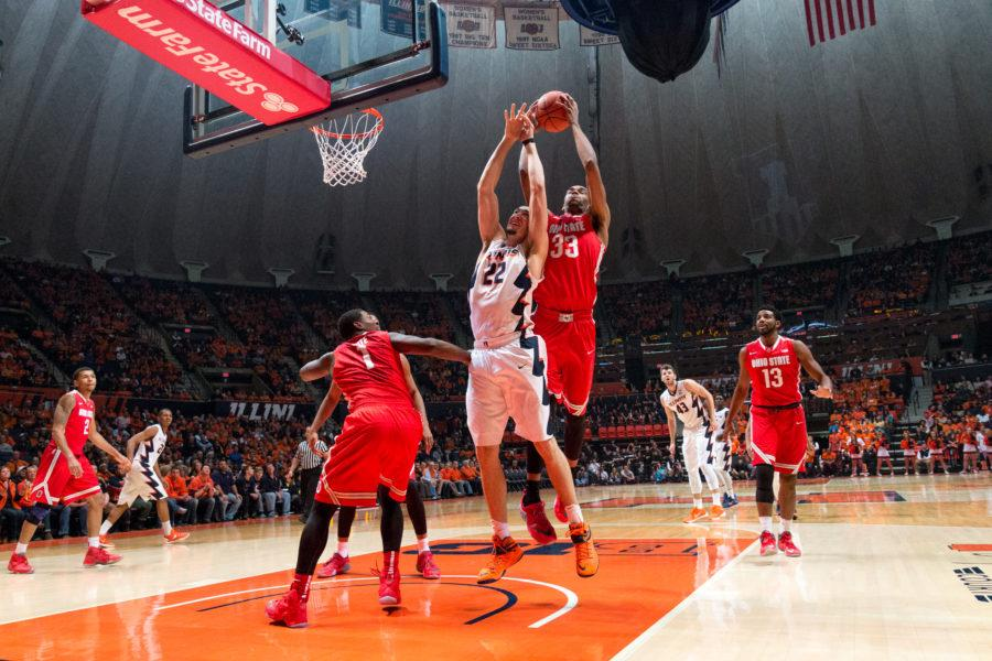 Ohio State's Kieta Bates-Diop (33) rises above Illinois' Maverick Morgan to snag a rebound. The Illini were out-rebounded by the Buckeyes 51-34 in Ohio State's 68-63 overtime win at State Farm Center on Thursday, Jan. 28.