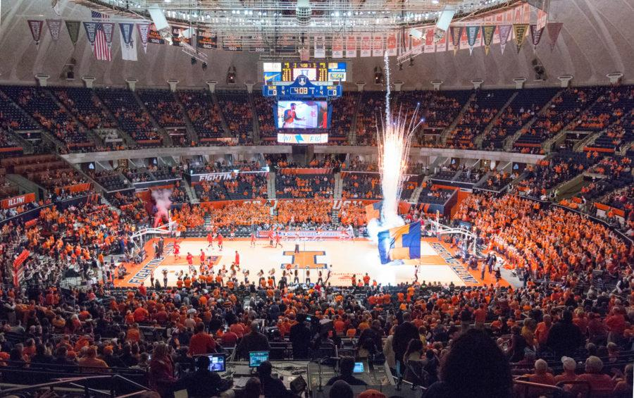 Fireworks shoot into the air inside State Farm Center.
