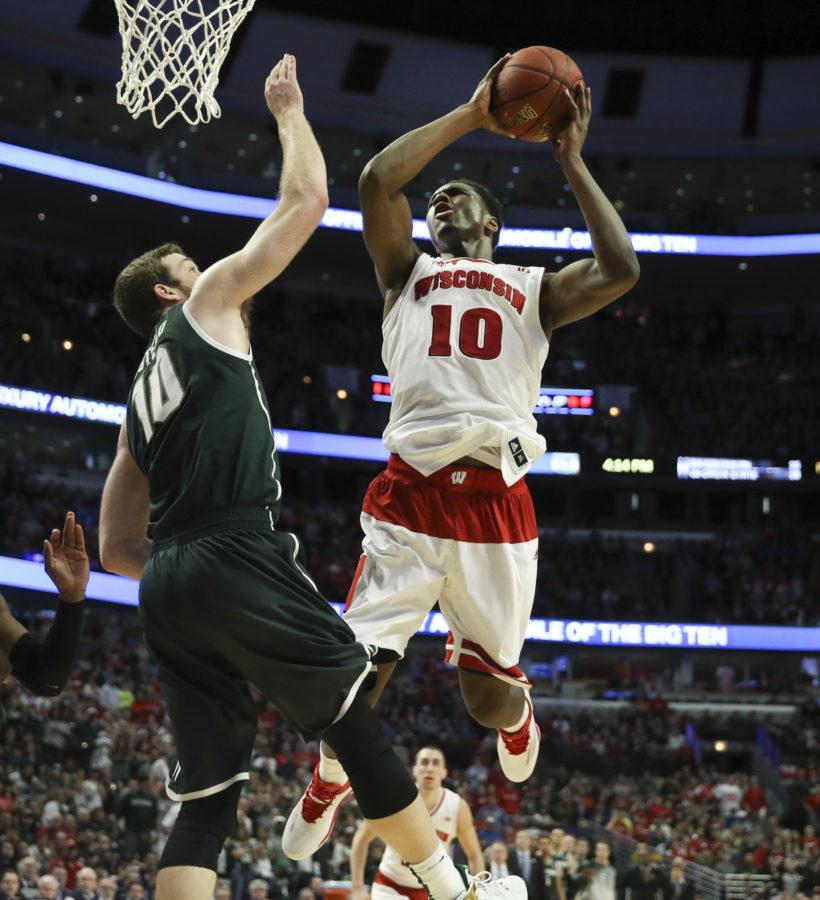 Wisconsin forward Nigel Hayes (10) goes to the basket against Michigan State forward Matt Costello (10) during overtime in the Big Ten Men's Tournament championship game on Sunday, March 15, at the United Center in Chicago.