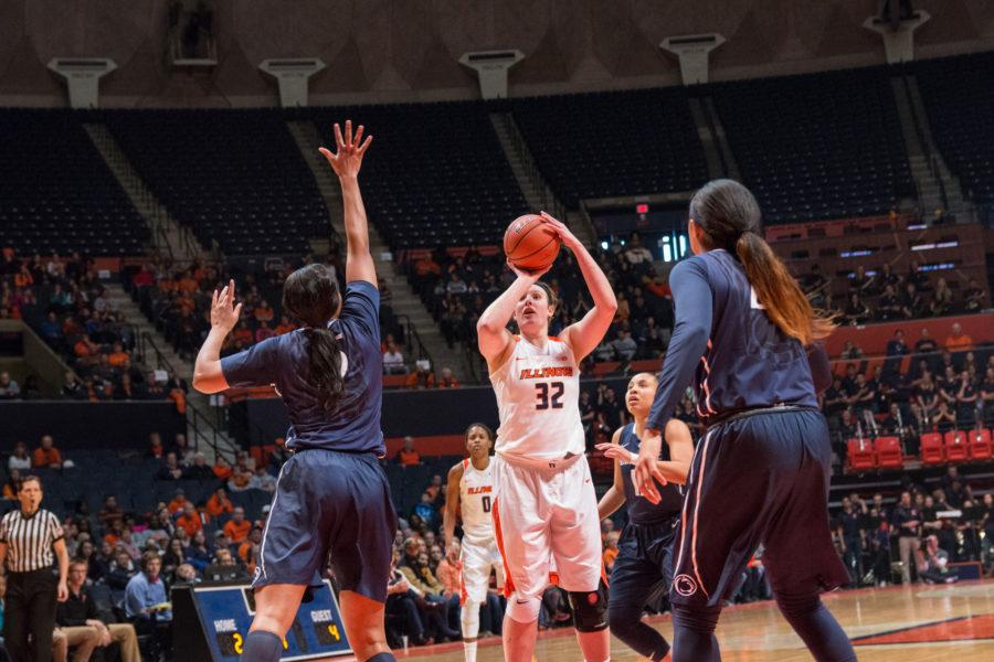 Illinois' Chatrice White takes a jump shot during the game against Penn State at the State Farm Center on January 23. The Illini lost 65-56.