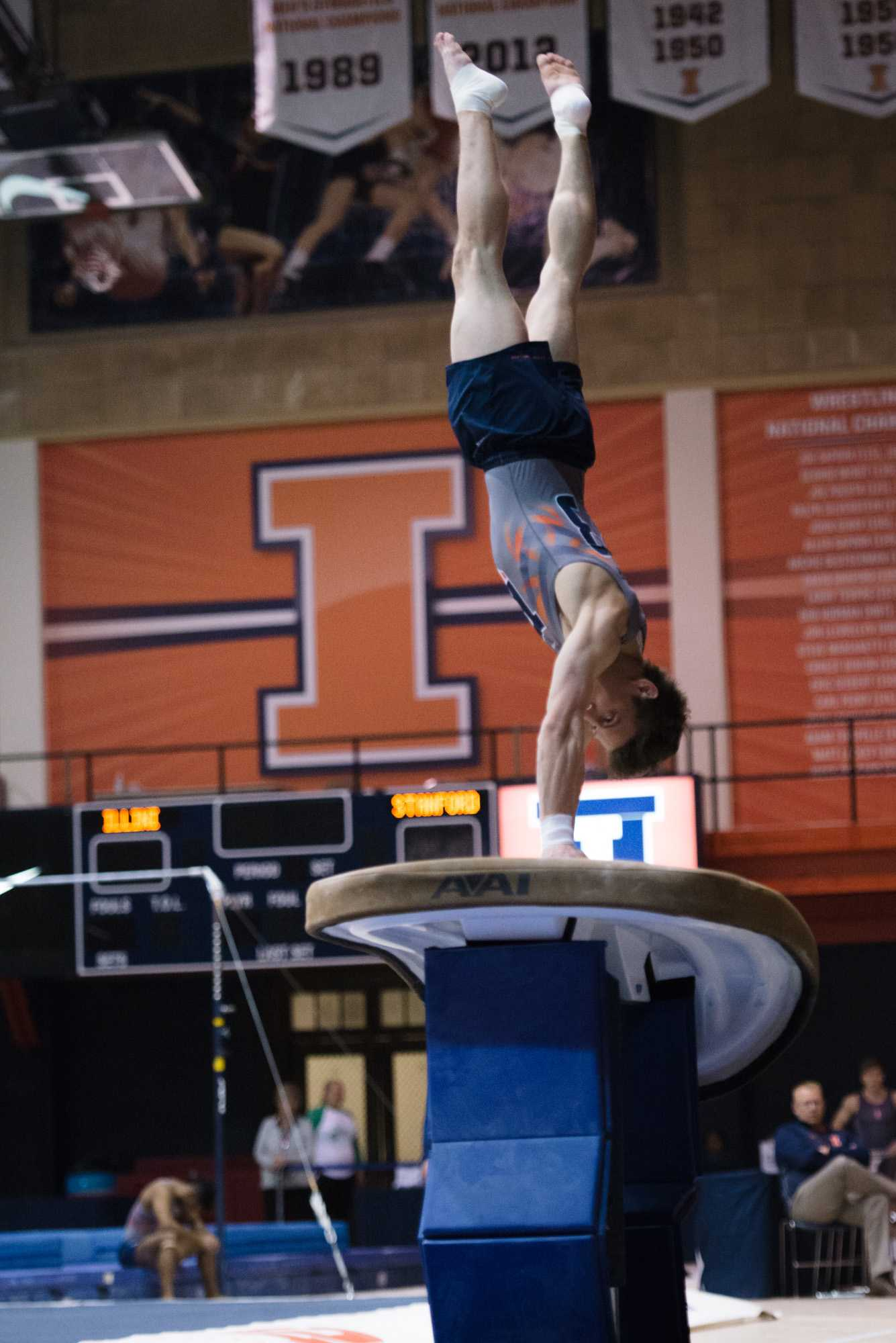 Illinois' Bobby Baker launches off the vault during the meet against Stanford at Huff Hall on Friday, March 6, 2015.The Illini lost 21-9.