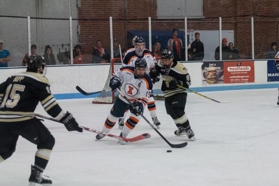 Illinois' Eric Cruickshank fights for possession of the puck during the game against Lindenwold University at the Ice Arena on Saturday, January 30. The Illini lost 4-1.
