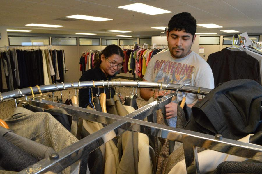 Seniors Wisa Terhune and Keven Zarate help each other search for new additions to their wardrobes at the Career Center's location on Green Street on Jan. 28 2016.