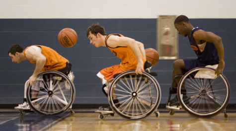 Wheelchair basketball player and Team USA captain Steve Serio (left) as a junior on Illinois' wheelchair basketball team. Serio, Will Waller (not pictured) and Brian Bell (right, as a freshman at Illinois) have qualified for Team USA for the 2016 Rio Paralympics. Also pictured is Tom Smurr, an Illinois freshman at the time.