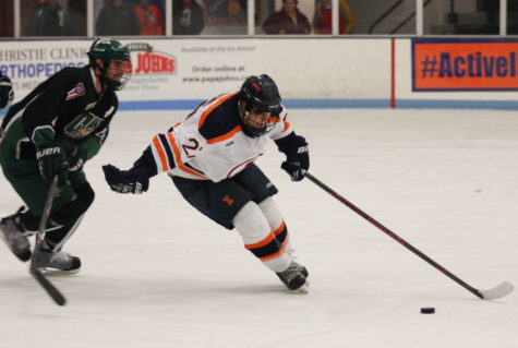 Illinois' Kyle Varzino (27) tries to keep the puck away from Ohio during the Ohio hockey game at the Ice Arena on Oct. 24. The Illini had a pair of matches this weekend against Aurora.