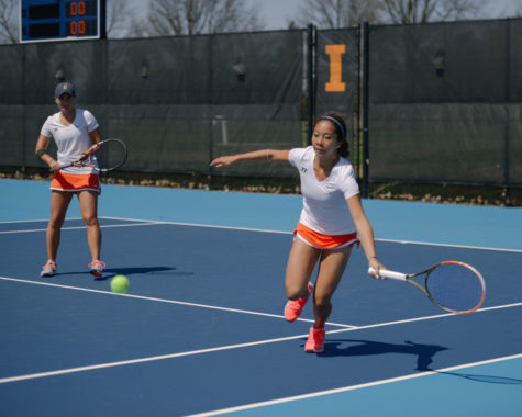 Illinois' Louise Kwong runs to the ball to make a return during the game against Maryland on Saturday, April 4.