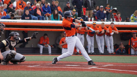 Illinois' Pat McInerney (27) pops up ball during the baseball game v. Purdue at Illinois Field on Sunday, April 12. The Illini won 5-1.