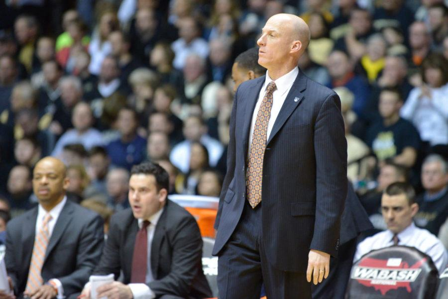 Folake Osibodu The Daily Illini Illinois' head coach John Groce watches the game against Purdue at Mackey Arena in West Lafayette, Indiana on Saturday, March 7, 2015. The Illini lost 63-58.