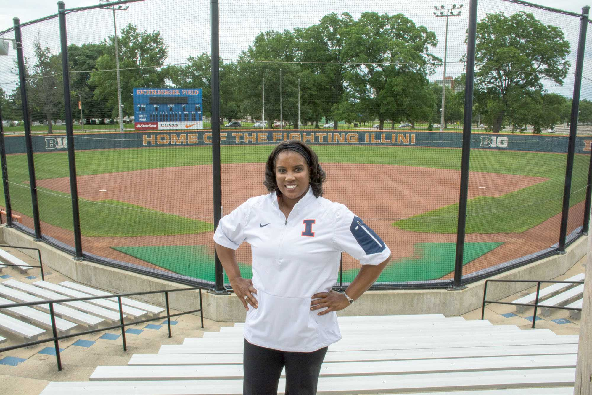 Tyra Perry, Illinois' new women's softball head coach, poses in her new Illini gear at Eichelberger Field after a press conference on June 25.