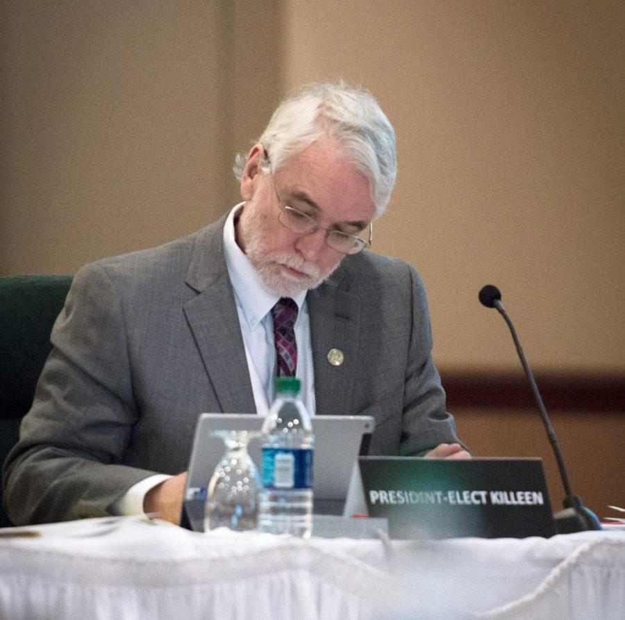 President-elect Timothy L. Killeen takes notes during the board of trustees meeting at the Illini Union on Thursday, March 12, 2015.