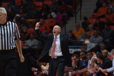 Illinois head coach John Groce shouts directions to his team during during the Illini's 84-70 victory over Purdue at State Farm Center on Sunday.