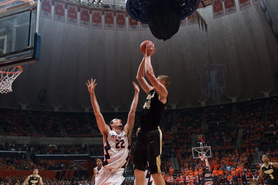Purdue's Isaac Haas shoots over Illinois' Maverick Morgan during the Illini's 84-70 victory over the Boilermakers at State Farm Center on Sunday.