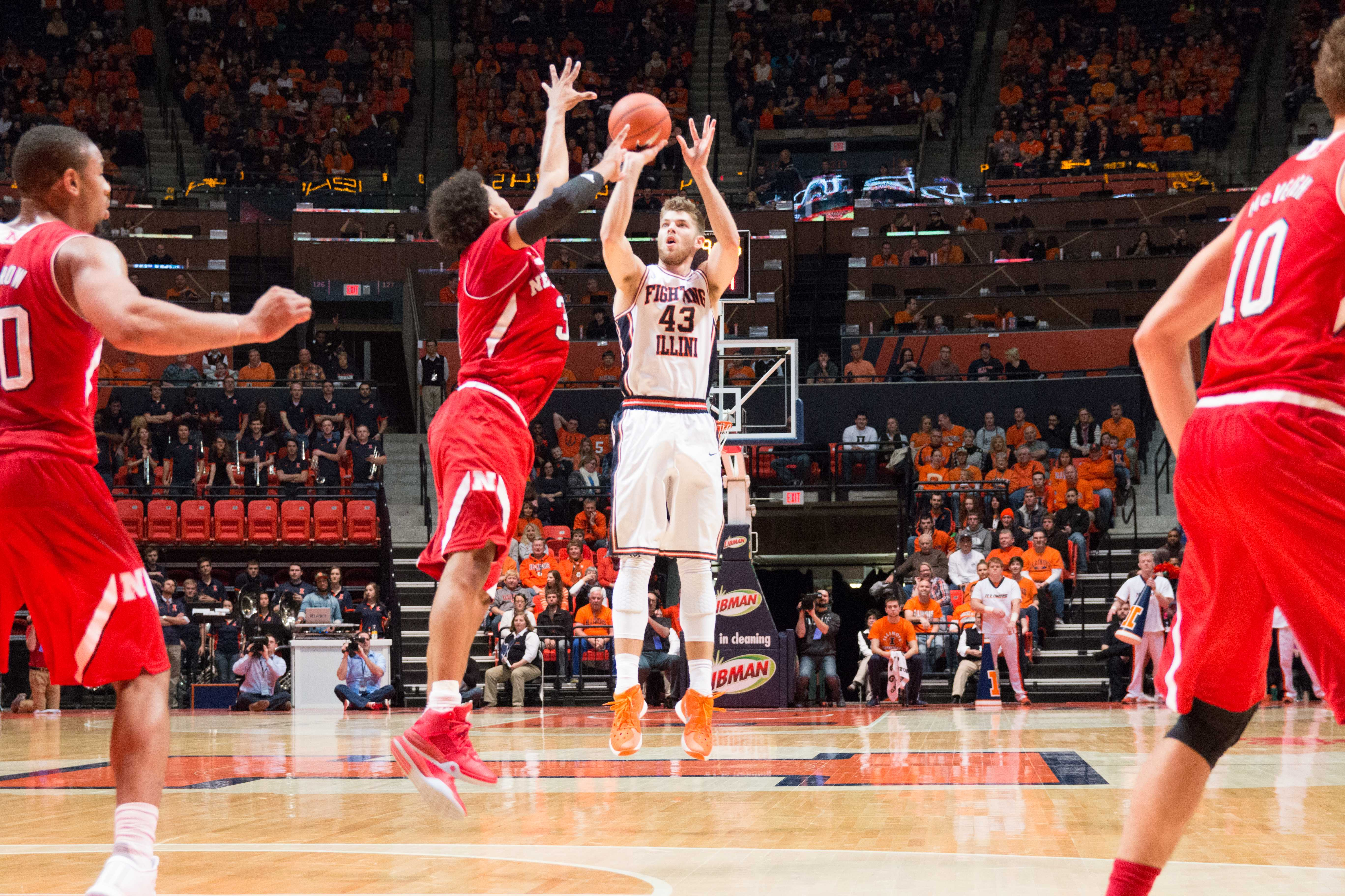 Illinois' Michael Finke shoots a 3-pointer over Nebraska's Shavon Shields during the Illini's 78-67 loss to the Huskers at State Farm Center on Saturday.
