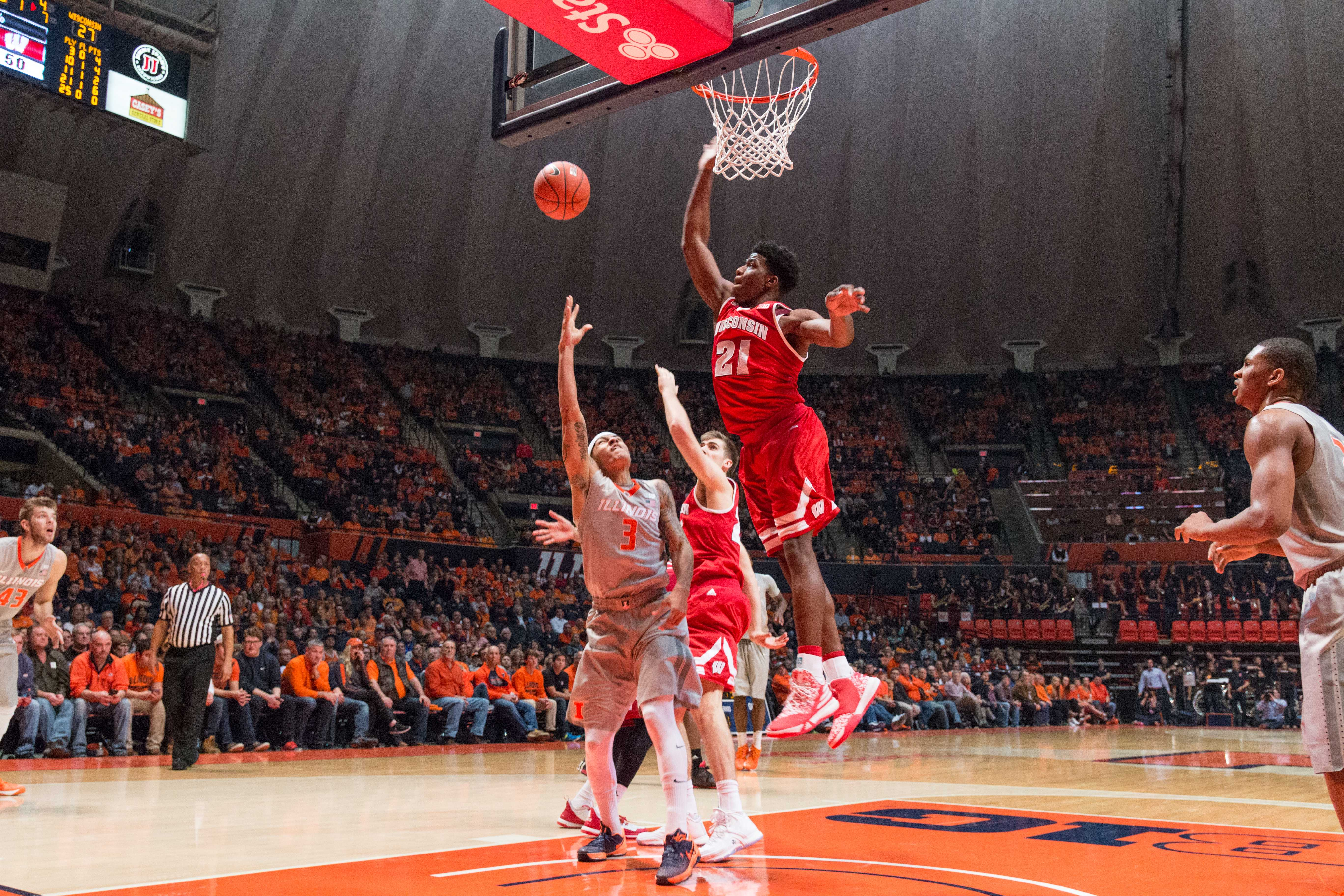 Wisconsin's Khalil Iverson (21) attempt to block Illinois guard Khalid Lewis' layup during the Illini's 63-55 loss to the Badgers at State Farm Center on Sunday, Jan. 31. The Illini have now lost three straight home games.