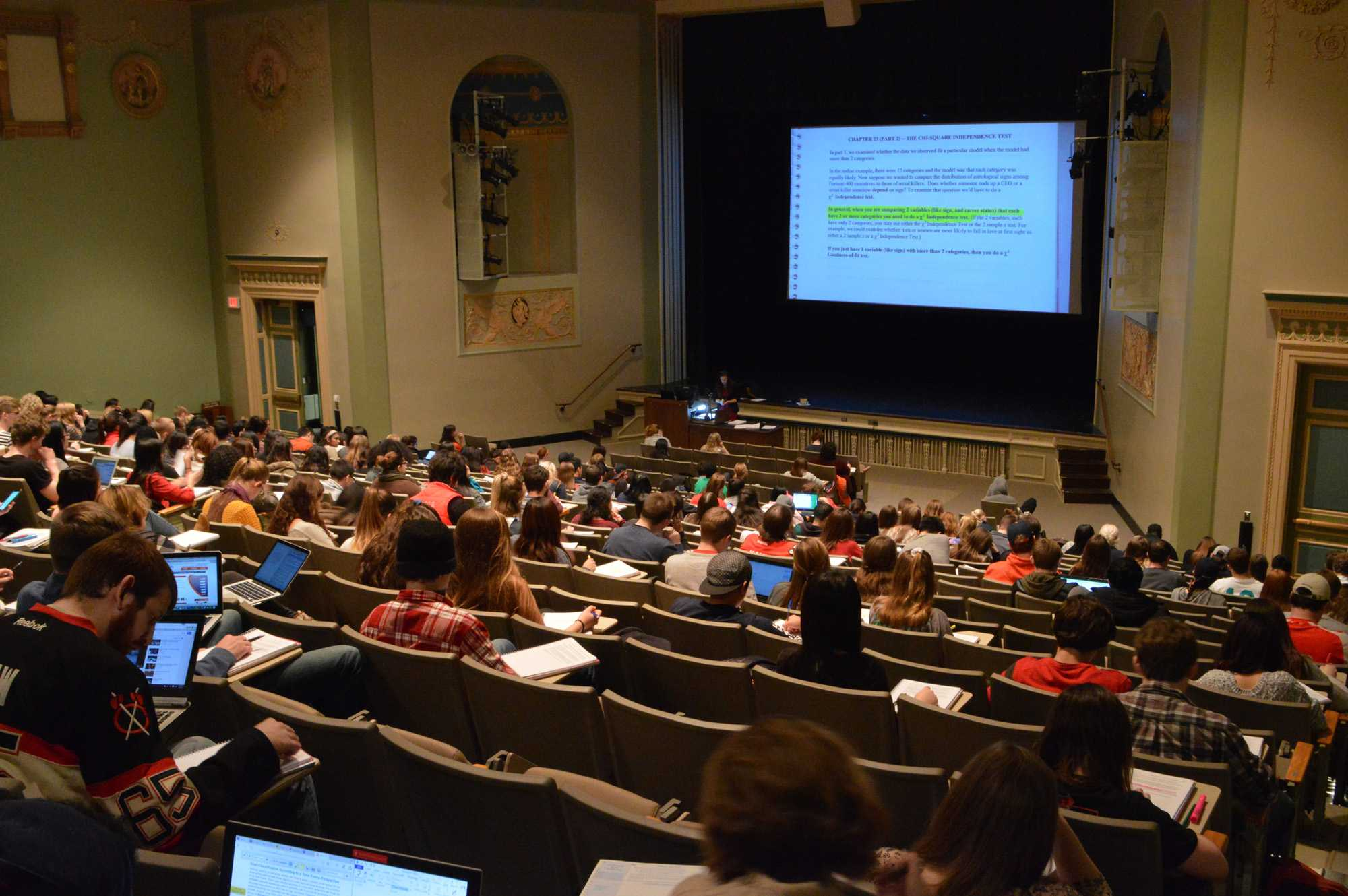 Statistics 100 students listen to newly hired instructor, Karle Laska, speak about the final few pages in the course manual on Dec 8, 2015.