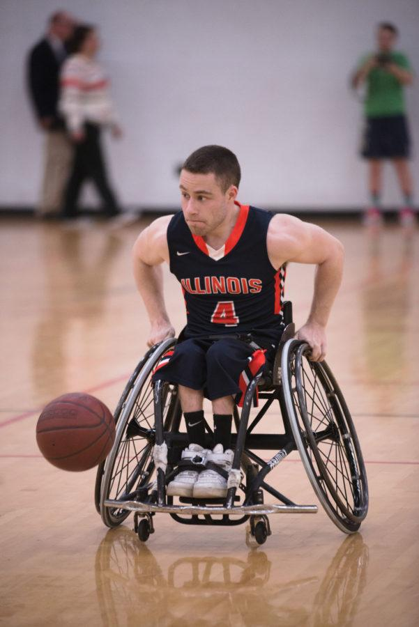 Illinois' Ryan Neiswender drives the ball down the court during the game against  Missouri at the Activities and Recreation Center on Friday, February 13, 2015.The Illini won 53-46.