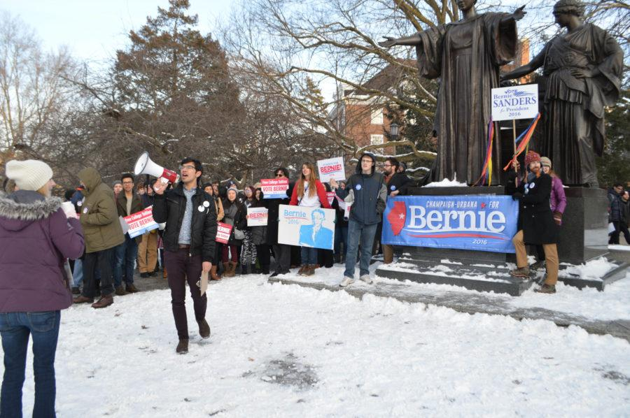 Brandon+Hudspeth%2C+a+senior+in+political+science%2C+leads+a+group+of+Sanders+supporters+in+a+variety+of+chants+in+front+of+the+Alma+Mater+as+part+of+the+March+for+Bernie+on+Jan.+23+2016.