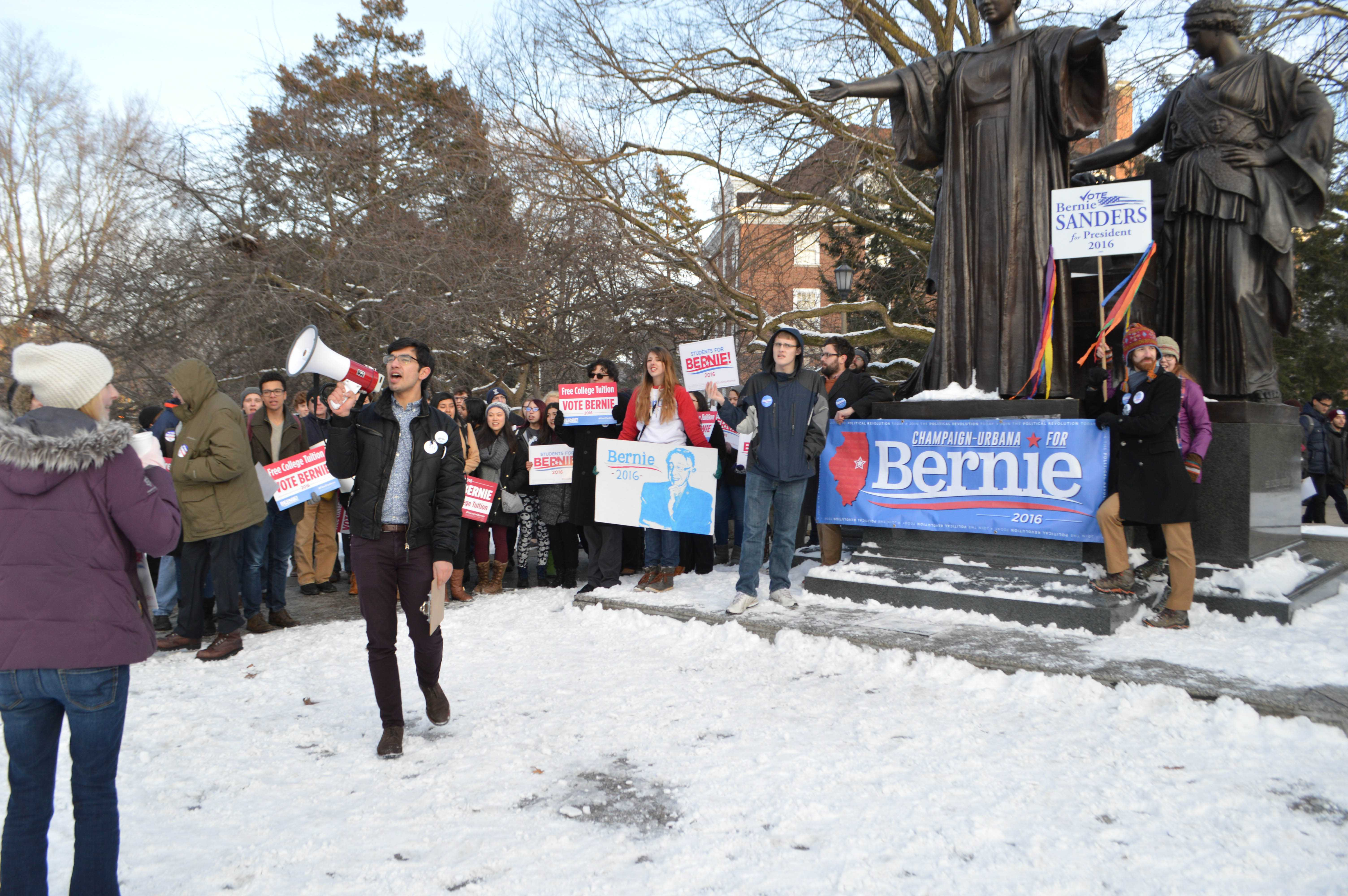 Brandon Hudspeth, a senior in political science, leads a group of Sanders supporters in a variety of chants in front of the Alma Mater as part of the March for Bernie on Jan. 23 2016.