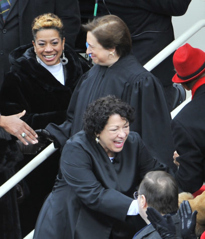 Supreme Court Justices Elena Kagan (top) and Sonia Sotomayor (bottom) greets fellow guests during the presidential inauguration on the West Front of the U.S. Capitol January 21, 2013 in Washington, DC.  Barack Obama was re-elected for a second term as President of the United States. (Mark Gail/MCT)