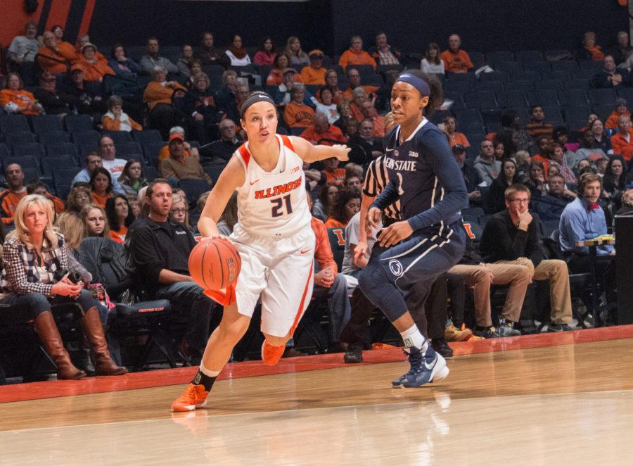 Illinois' Brooke Kissinger drives to the basket during the game against Penn State at the State Farm Center on January 23. The Illini lost 65-56.