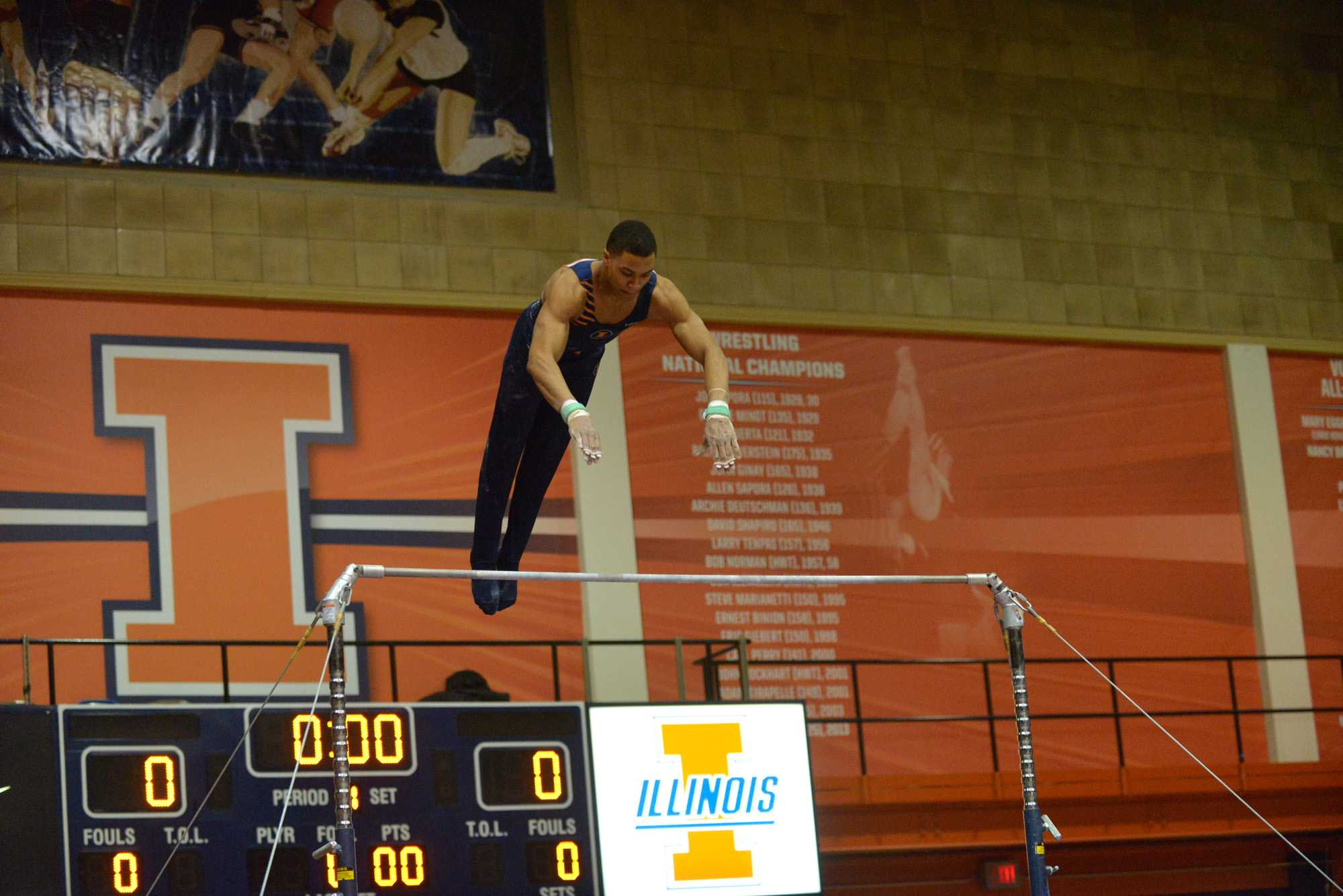 Chandler Eggleston performs the high bar routine against Ohio State at Huff Hall on Sunday, Jan. 26rd, 2014.