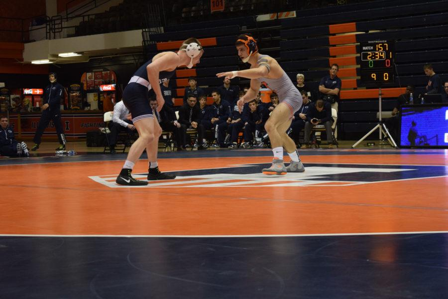 Illinois' Isaiah Martinez starting off strong against Penn State's Jason Nolf during the wrestling match vs. Penn State at Huff Hall on Saturday January 23, 2016. The Illini lost 19-1.