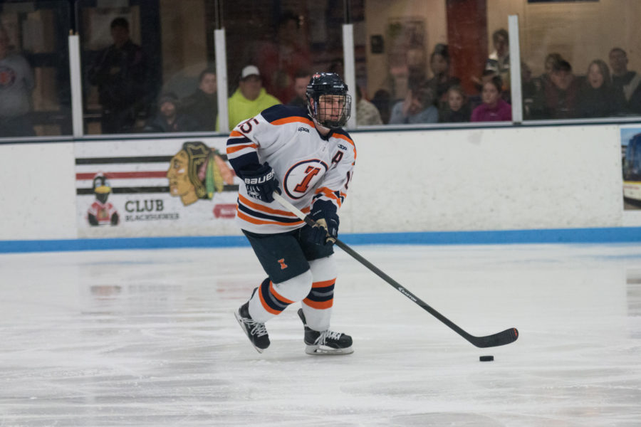 Illinois Eric Cruickshank carries the puck up the ice during the game against Lindenwold University at the Ice Arena on Saturday, January 30. The Illini lost 4-1.