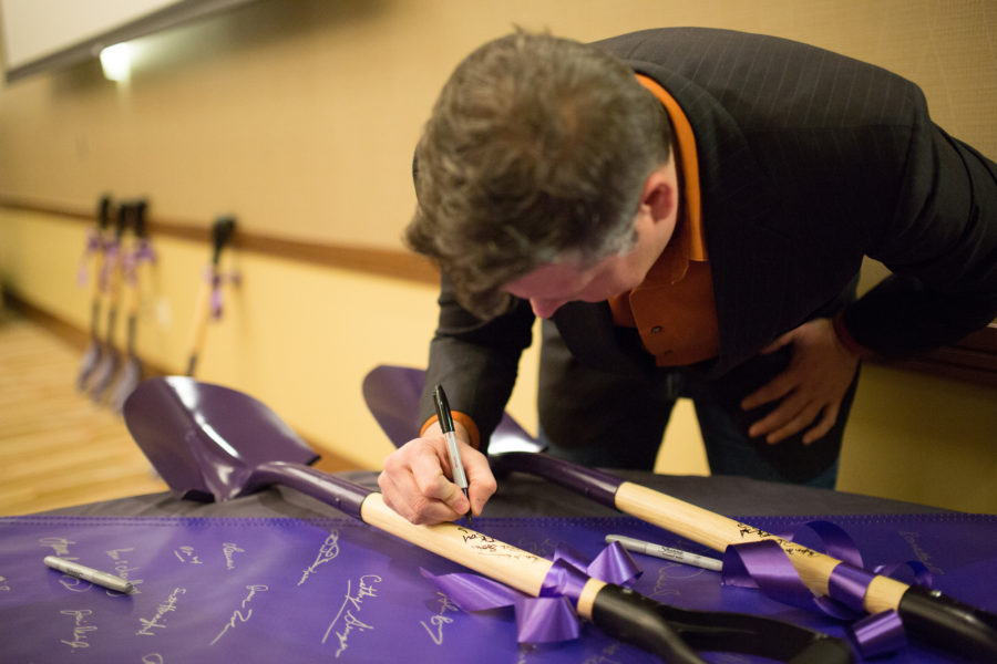 Don Gerard, Mayor of Champaign, signs a shovel during the Yahoo! Groundbreaking event at the IHotel on Wednesday, Feb. 5, 2014
