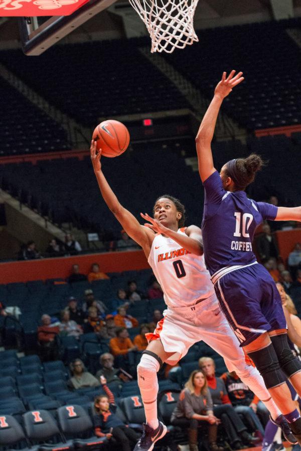 Illinois' Sarah Hartwell takes a layup over Northwestern's Nia Coffey during the game against Northwestern at State Farm Center on February 4. The Illini lost 69-59.