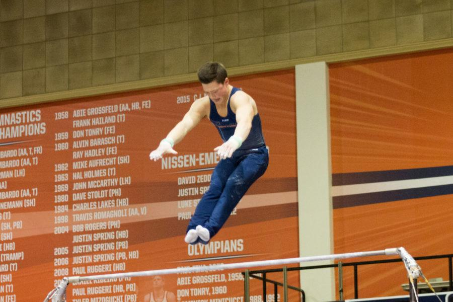 Illinois' Alex Diab performs a routine on the high bar during the meet against Temple & UIC at Huff Hall on Saturday, Feb. 6, 2016.