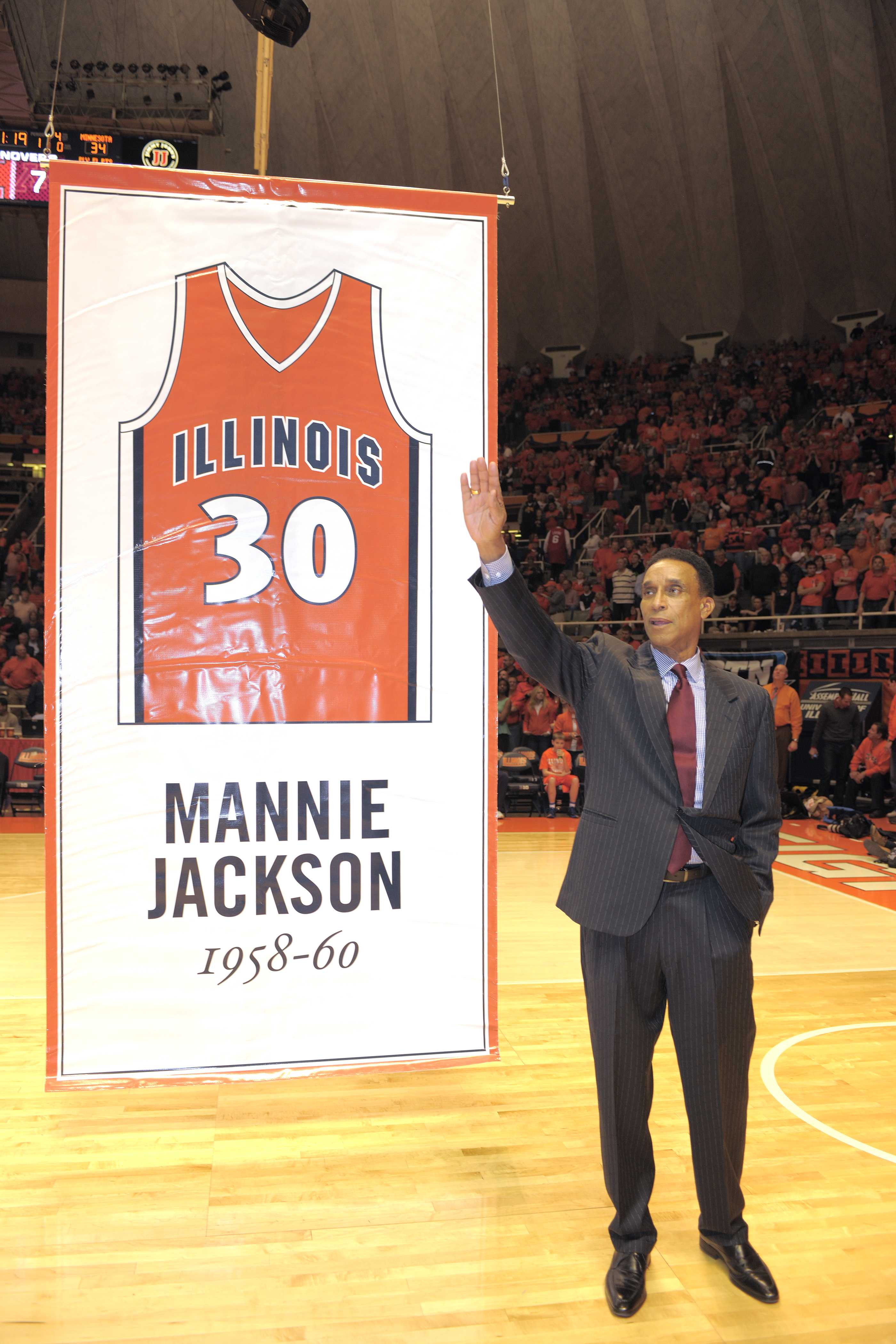 Mannie+Jackson+stands+on+court+as+his+number+is+prepared+to+be+hung+in+the+rafters+at+then-Assembly+Hall+in+early%26nbsp%3B2013.+Jackson+was+a+pioneer+for+Illini+basketball+as+one+of+the+first+African+Americans+to+letter+for+the+team.%26nbsp%3B