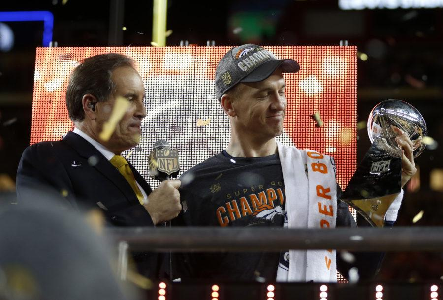 Denver Broncos starting quarterback Peyton Manning, right, holds the Lombardi Trophy after the Broncos' 24-10 win against the Carolina Panthers in Super Bowl 50 at Levi's Stadium in Santa Clara, Calif., on Sunday, Feb. 7, 2016. The Broncos won, 24-10. (Nhat V. Meyer/Bay Area News Group/TNS)