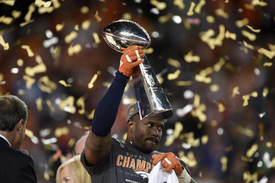 The game's Most Valuable Player, Denver Broncos linebacker Von Miller, celebrates as he holds the Vince Lombardi trophy after a 24-10 win against the Carolina Panthers in Super Bowl 50 at Levi's Stadium in Santa Clara, Calif., on Sunday, Feb. 7, 2016. (Jose Carlos Fajardo/Bay Area News Group/TNS)